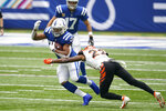 Indianapolis Colts' Jonathan Taylor (28) is tackled by Cincinnati Bengals' William Jackson (22) during the first half of an NFL football game, Sunday, Oct. 18, 2020, in Indianapolis. (AP Photo/Michael Conroy)