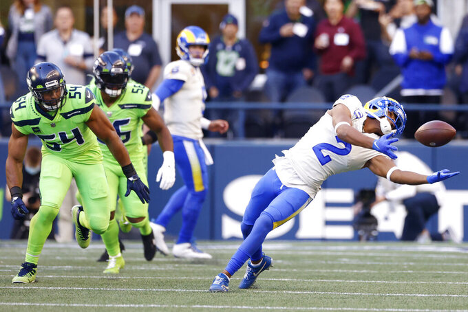 Los Angeles Rams wide receiver Robert Woods (2) makes a catch as Seattle Seahawks middle linebacker Bobby Wagner (54) looks on during the first half of an NFL football game, Thursday, Oct. 7, 2021, in Seattle. (AP Photo/Craig Mitchelldyer)