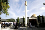 His Royal Highness Prince El Hassan bin Talal Hashemite of the Kingdom of Jordan and his entourage are escorted to the Al Noor mosque in Christchurch, New Zealand, Saturday, March 23, 2019. The mosque reopened today following the March 15 mass shooting. (AP Photo/Mark Baker)