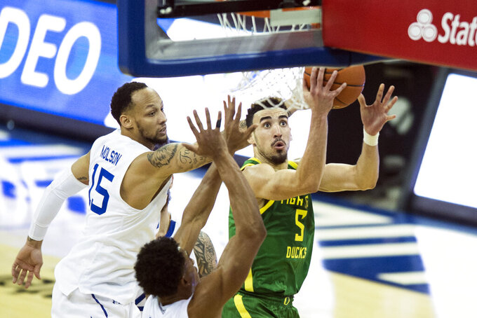 Oregon's Chris Duarte, right, scores against Seton Hall's Takal Molson, left, and Jared Rhoden during the second half of an NCAA college basketball game in Omaha, Neb., Friday, Dec. 4, 2020. (AP Photo/Kayla Wolf)