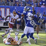 New York Giants cornerback Janoris Jenkins, right, runs with the ball after he intercepted it during the second half of an NFL football game against the Washington Redskins, Sunday, Sept. 29, 2019, in East Rutherford, N.J. (AP Photo/Bill Kostroun)