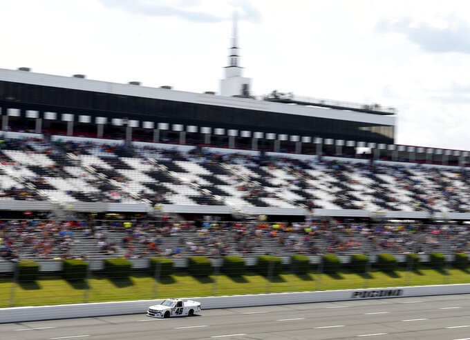 Ross Chastain drives down the front stretch during a NASCAR Truck Series auto race, Saturday, July 27, 2019, in Long Pond, Pa. Chastain won the race. (AP Photo/Derik Hamilton)