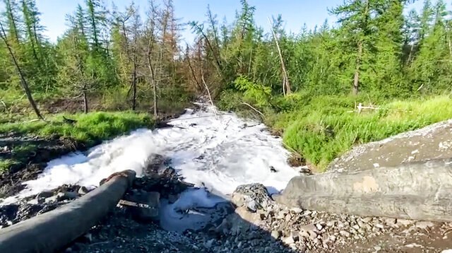 In this handout frame taken from video released Sunday June 28, 2020, by Novaya Gazeta, showing what the report is water from a Norilsk Nickel enrichment plant gushing out of a pipe and into a river which also runs into the lake near Norilsk, 2,900 kilometers (1,800 miles) northeast of Moscow, Russia. Russia's main criminal investigation body has launched a probe after a report that a nickel-processing plant was pumping water contaminated with heavy metals into the Arctic tundra.  (Elena Kostyuchenko, Novaya Gazeta via AP)