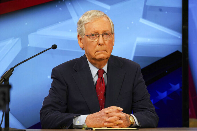 Senate Majority Leader Mitch McConnell, R-Ky., prepares for the start of his debate with democratic candidate Amy McGrath in Lexington, Ky., Monday, Oct. 12, 2020. (Michael Clubb, The Kentucky Kernel via AP Pool)