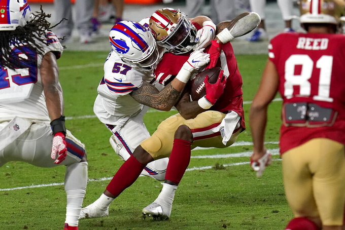 San Francisco 49ers running back Jeff Wilson (30) is hit by Buffalo Bills defensive end A.J. Epenesa (57) during the second half of an NFL football game, Monday, Dec. 7, 2020, in Glendale, Ariz. (AP Photo/Ross D. Franklin)