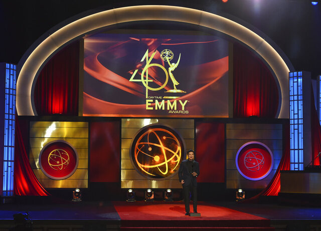 "FILE - This May 5, 2019 file photo shows host Mario Lopez on stage at the 46th annual Daytime Emmy Awards in Pasadena, Calif. The Daytime Emmy Awards are skipping a theater ceremony because of the coronavirus but the honors will be presented on a TV broadcast on June 26. Nominations for the 47th annual Daytime Emmys will be announced Thursday on CBS' ""The Talk,"" with categories including best drama series, talk show and game show. The TV academy that organizes the daytime awards had announced it wouldn't hold the traditional theater ceremony out of pandemic safety concerns. (Photo by Chris Pizzello/Invision/AP, File)"
