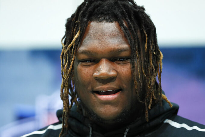 FILE - Georgia offensive lineman Isaiah Wilson speaks during a press conference at the NFL football scouting combine in Indianapolis, in this Wednesday, Feb. 26, 2020, file photo. The New York Giants have signed tackle Isaiah Wilson to their practice squad, giving the former first-round draft pick another chance to overcome off-the-field issues and make it in the NFL.Wilson was taken 29th overall in last year's draft by the Tennessee Titans out of Georgia.  (AP Photo/Charlie Neibergall, File)