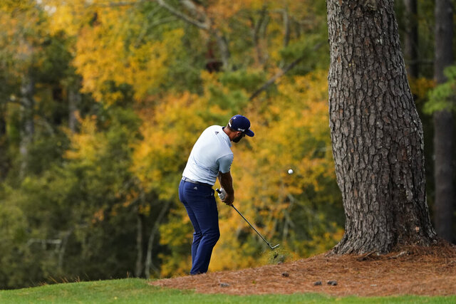 Dustin Johnson hits out of the rough on the third fairway during a practice round for the Masters golf tournament Monday, Nov. 9, 2020, in Augusta, Ga. (AP Photo/Matt Slocum)
