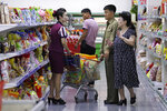 FILE - In this Sept. 12, 2018, file photo, North Korean customers get assistance at a supermarket in Pyongyang, North Korea. In the highly formalized world of China-North Korea relations, Chinese President Xi Jinping's trip to Pyongyang carries enormous symbolic significance. Although less certain, it may also yield outcomes that could influence both countries' relations with the U.S.(AP Photo/Kin Cheung, File)