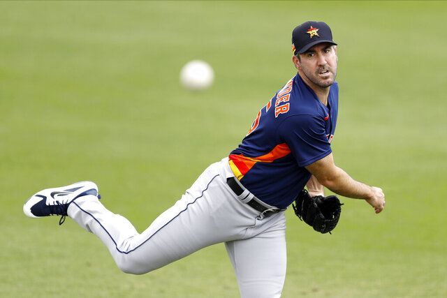 "FILE - In this March 3, 2020, file photo, Houston Astros pitcher Justin Verlander warms up prior to the team's spring training baseball game against the St. Louis Cardinals in Jupiter, Fla.  Verlander has resumed throwing as he recovers from March groin surgery. Houston manager Dusty Baker said Wednesday, April 15, that Verlander, who had surgery on March 17, is ""doing great"