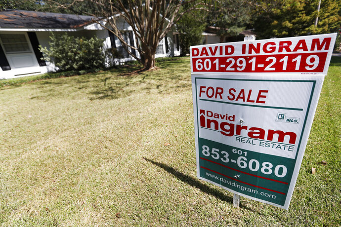 In this Sept. 25, 2019, photo a realtor's sign sits outside a house for sale in Jackson, Miss. On Thursday, Oct. 3, Freddie Mac reports on this week's average U.S. mortgage rates. (AP Photo/Rogelio V. Solis)