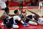 United States' Harrison Barnes at reaches for the ball near Greece's Thanasis Antetokounmpo, left and Greece's Giannis Antetokounmpo at center during phase two of the FIBA Basketball World Cup at the Shenzhen Bay Sports Center in Shenzhen in southern China's Guangdong province on Saturday, Sept. 7, 2019. United States beats Greece 69-53. (AP Photo/Ng Han Guan)