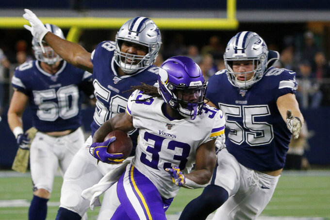 FILE - In this Nov. 10, 2019, file photo, Minnesota Vikings running back Dalvin Cook (33) runs the ball as Dallas Cowboys' Robert Quinn (58) and Leighton Vander Esch (55) give chase during the first half of an NFL football game in Arlington, Texas. Cook is in position to win his first NFL rushing title after two injury-plagued seasons, which could also help him in the AP MVP voting. (AP Photo/Michael Ainsworth, File)