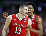 Texas Tech guard Matt Mooney (13) celebrates after making a three-point basket during the second half against Michigan State in the semifinals of the Final Four NCAA college basketball tournament, Saturday, April 6, 2019, in Minneapolis. (AP Photo/Jeff Roberson)