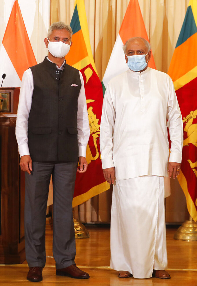 Sri Lankan Foreign Minister Dinesh Gunawardena, right, stands for a photograph with his Indian counterpart Subrahmanyam Jaishankar after addressing a joint media briefing in Colombo, Sri Lanka, Wednesday, Jan. 6, 2021. (AP Photo/Eranga Jayawardena)