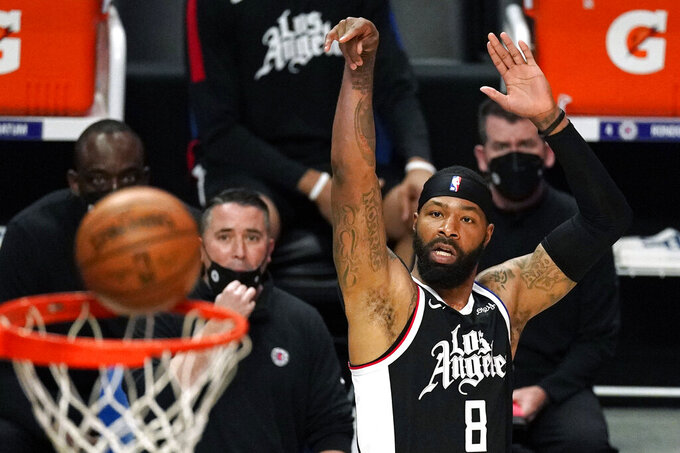 Los Angeles Clippers forward Marcus Morris Sr. watches his shot go in during the first half of an NBA basketball game against the Denver Nuggets Saturday, May 1, 2021, in Los Angeles. (AP Photo/Mark J. Terrill)