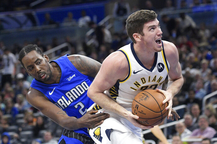 Indiana Pacers forward T.J. Leaf (22) drives to the basket past Orlando Magic forward Al-Farouq Aminu (2) during the second half of an NBA basketball game Sunday, Nov. 10, 2019, in Orlando, Fla. (AP Photo/Phelan M. Ebenhack)
