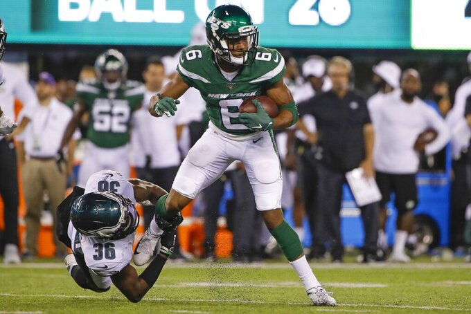 Philadelphia Eagles' Deiondre' Hall (36) tackles New York Jets' Tim White (6) during the second half of a preseason NFL football game Thursday, Aug. 29, 2019, in East Rutherford, N.J. (AP Photo/Matt Rourke)