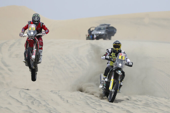 Ricky Brabec of United States, left, rides his Honda motorbike and Pablo Quintanilla of Chile rides his Husqvarna during the second stage of the Dakar Rally across the dunes between Pisco and San Juan de Marcona, Peru, Tuesday, Jan. 8, 2019. (AP Photo/Ricardo Mazalan)