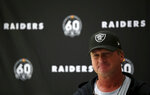 Oakland Raiders head coach Jon Gruden attends a press conference during the media day at The Grove Hotel, Watford, England, Friday, Oct. 4, 2019. The Oakland Raiders are preparing for an NFL regular season game against the Chicago Bears in London on Sunday. (Steven Paston/PA via AP)
