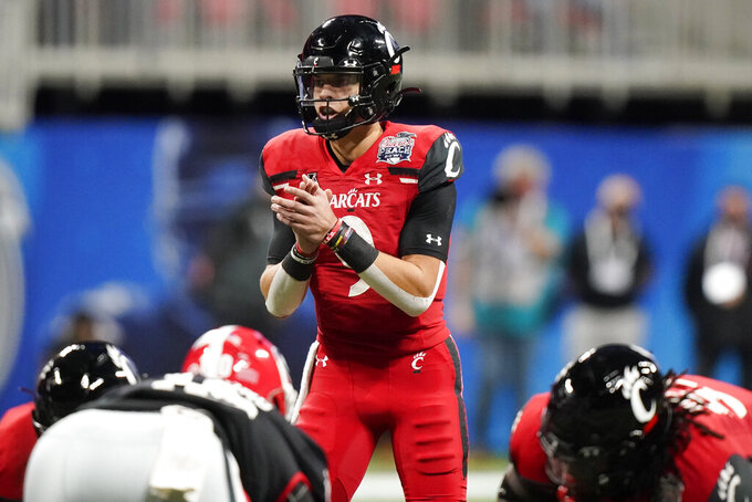 Cincinnati quarterback Desmond Ridder (9) calls a play against Georgia during the first half of the Peach Bowl NCAA college football game, Friday, Jan. 1, 2021, in Atlanta. (AP Photo/Brynn Anderson)