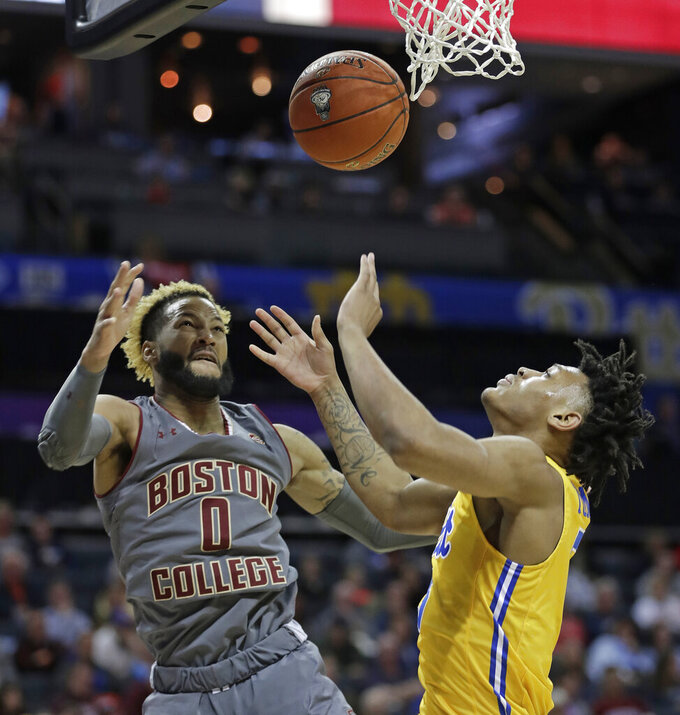 Boston College's Ky Bowman (0) and Pittsburgh's Au'Diese Toney vie for a rebound during the first half of an NCAA college basketball game in the Atlantic Coast Conference men's tournament in Charlotte, N.C., Tuesday, March 12, 2019. (AP Photo/Nell Redmond)