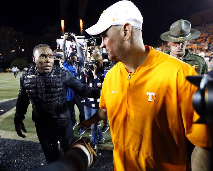 Vanderbilt head coach Derek Mason, left, meets Tennessee head coach Jeremy Pruitt on the field after an NCAA college football game Saturday, Nov. 24, 2018, in Nashville, Tenn. (AP Photo/Mark Humphrey)