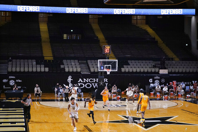 Vanderbilt and Valparaiso play with no fans in the arena during the first half of an NCAA college basketball game Friday, Nov. 27, 2020, in Nashville, Tenn. (AP Photo/Mark Humphrey)