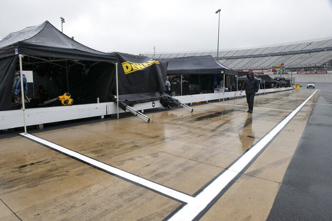 Rain falls before the start of a NASCAR Cup series auto race at Dover International Speedway in Dover, Del., Sunday, May 5, 2019. (AP Photo/Jason Minto)