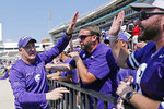 Kansas State head coach Chris Klieman is congratulated by fans following their NCAA college football game win 31-24 over Mississippi State in Starkville, Miss., Saturday, Sept. 14, 2019. (AP Photo/Rogelio V. Solis)