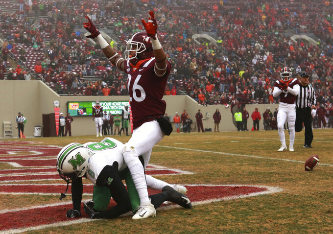 Jovonn Quillen (26) of Virginia Tech reacts to defending a touchdown pass attempt to Tyre Brady (8) of Marshall in the first quarter  of an NCAA college football game in Blacksburg Va. Saturday, Dec. 1 2018. (Matt Gentry/The Roanoke Times via AP)