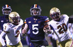 Virginia quarterback Brennan Armstrong (5) runs with the ball against Boston College during an NCAA college football game Saturday, Dec. 5, 2020, in Charlottesville, Va. (Erin Edgerton/The Daily Progress via AP)