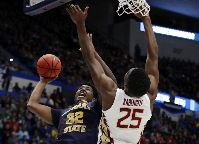Murray State's Darnell Cowart (32) goes up for a shot against Florida State's Mfiondu Kabengele (25) during the first half of a second round men's college basketball game in the NCAA Tournament, Saturday, March 23, 2019, in Hartford, Conn. (AP Photo/Elise Amendola)