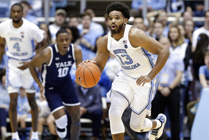 North Carolina guard Jeremiah Francis (13) dribbles during the first half of an NCAA college basketball game against Yale in Chapel Hill, N.C., Monday, Dec. 30, 2019. (AP Photo/Gerry Broome)