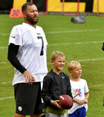 Pittsburgh Steelers quarterback Ben Roethlisberger stands with his children, Ben Jr. and Bodie, during the NFL football team's training camp Wednesday, Aug. 18, 2021, in Pittsburgh. (Matt Freed/Pittsburgh Post-Gazette via AP)