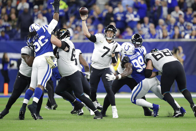 Jacksonville Jaguars quarterback Nick Foles (7) throws a touchdown pass during the first half of an NFL football game against the Indianapolis Colts, Sunday, Nov. 17, 2019, in Indianapolis. (AP Photo/Michael Conroy)
