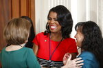 FILE - In this Feb. 16, 2017, file photo, Omarosa Manigault, then-director of communications for the White House Office of Public Liaison, center, speaks in the East Room of the White House in Washington, before the start of President Donald Trump's news conference. Omarosa Manigault Newman says she has concluded, after years of defending Donald Trump, that he is a bigot. She writes in a new book,