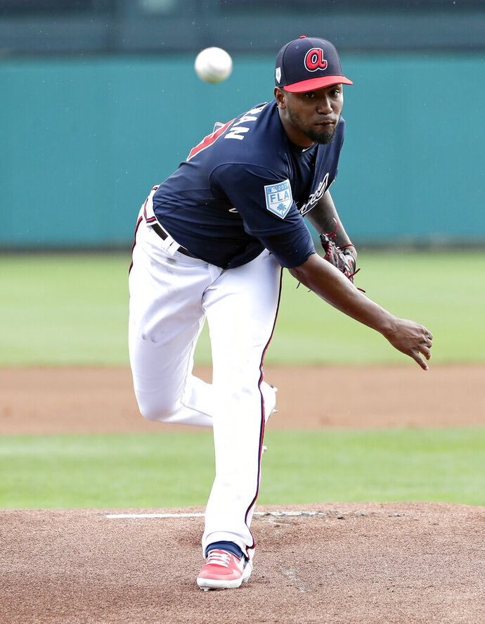 Atlanta Braves' Julio Teheran pitches in the first inning a spring baseball exhibition game against the Houston Astros, Monday, March 4, 2019, in Kissimmee, Fla. (AP Photo/John Raoux)