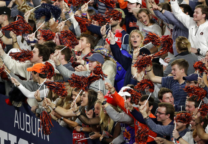 Auburn fans cheer before a semifinal round game against Virginia in the Final Four NCAA college basketball tournament, Saturday, April 6, 2019, in Minneapolis. (AP Photo/Matt York)