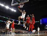 Virginia guard De'Andre Hunter (12) drives to the basket over Texas Tech's Matt Mooney (13), Jarrett Culver (23) and Tariq Owens, right, during the first half in the championship of the Final Four NCAA college basketball tournament, Monday, April 8, 2019, in Minneapolis. (AP Photo/Jeff Roberson)