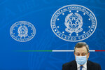 Italian Premier Mario Draghi meets the media during a news conference to illustrate the government's new measures to cope with COVID-19 pandemic, in Rome, Friday, April 16, 2021. (Remo Casilli/Pool via AP)