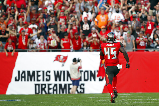 Tampa Bay Buccaneers linebacker Devin White (45) heads for the endzone after returing a fumble by Atlanta Falcons quarterback Matt Ryan 91-yards for a touchdown during the first half of an NFL football game Sunday, Dec. 29, 2019, in Tampa, Fla. (AP Photo/Mark LoMoglio)