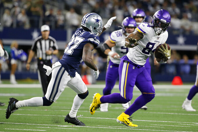 Dallas Cowboys cornerback Jourdan Lewis (27) gives chase as Minnesota Vikings tight end Irv Smith (84) finds running room after catching a pass during the first half of an NFL football game in Arlington, Texas, Sunday, Nov. 10, 2019. (AP Photo/Michael Ainsworth)
