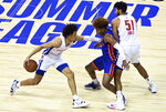 Detroit Pistons guard Cade Cunningham (2) brings the ball up as New York Knicks guard Miles McBride   defends during the first half of an NBA summer league basketball game Friday, Aug. 13, 2021, in Las Vegas. (AP Photo/David Becker)