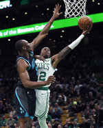 Boston Celtics guard Terry Rozier, right, drives to the basket against Charlotte Hornets center Bismack Biyombo, left, during the first quarter of an NBA basketball game in Boston, Wednesday, Jan. 30, 2019. (AP Photo/Charles Krupa)