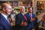 Labor Secretary Eugene Scalia, left, and Atlanta Gov. Brian Kemp join Vice President Mike Pence at the Star Cafe, Friday, May 22, 2020, in Atlanta. Pence said Georgia was