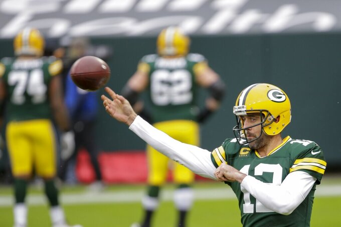 Green Bay Packers' Aaron Rodgers throws before an NFL football game against the Minnesota Vikings Sunday, Nov. 1, 2020, in Green Bay, Wis. (AP Photo/Mike Roemer)