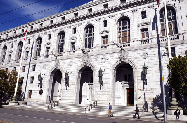 FILE - In this Jan. 2, 2019, file photo, people walk past the Earl Warren Building that houses the California Supreme Court in San Francisco. Los Angeles County must pay a full $8 million damages award to the family of a Black man whose death evoked the more resent death of George Floyd in Minneapolis, the California Supreme Court ruled Monday, Aug. 10, 2020. While subduing Darren Burley in 2012, Los Angeles sheriff's deputies