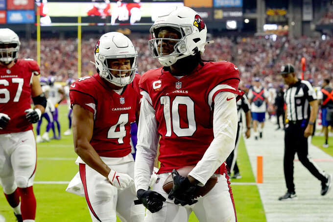 Arizona Cardinals wide receiver DeAndre Hopkins (10) celebrates his touchdown catch against the Minnesota Vikings with wide receiver Rondale Moore (4) during the first half of an NFL football game, Sunday, Sept. 19, 2021, in Glendale, Ariz. (AP Photo/Rick Scuteri)
