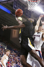 Arkansas-Pine Bluff forward Terrance Banyard, left, shoots in front of Gonzaga forward Filip Petrusev during the first half of an NCAA college basketball game in Spokane, Wash., Saturday, Nov. 9, 2019. (AP Photo/Young Kwak)